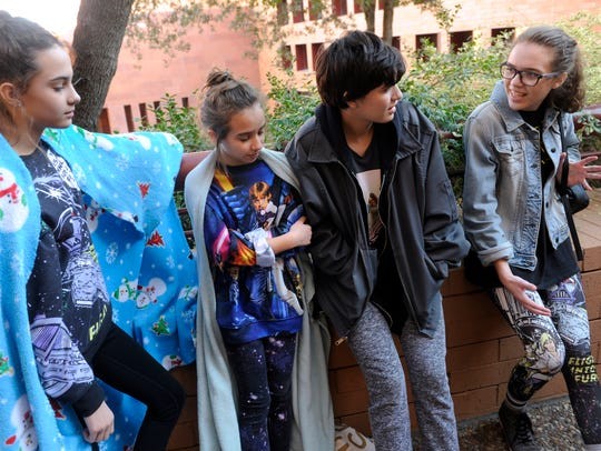 Sisters Tatumn Rose, 13; Katelyn, 11, Adyson, 16 and Regan, 15, talk about their enthusiasm for Star Wars while waiting in line to see the latest installment of the saga Thursday.