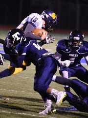 Thurston's Antwain Dungy brings down a Fitzgerald ball-carrier with a textbook tackle.