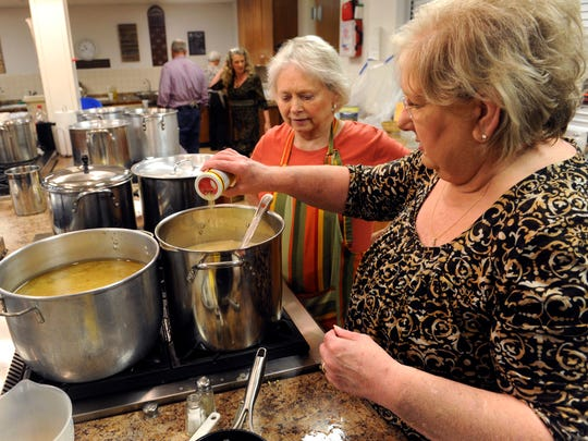 Elaine Goswick (left) watches as Jane Asher adds a little seasoning to a gravy pot Thursday. First United Methodist Church in Breckenridge has held its annual Thanksgiving fundraiser dinner since the early 1950s.