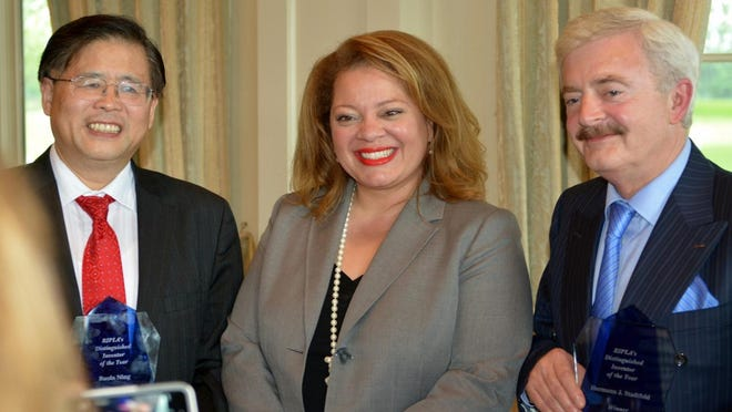 Ruola Ning, left, and Hermann Stadtfeld, right, with master of ceremonies Norma Holland after receiving the 2015 Distinguished Inventor of the Year Award.