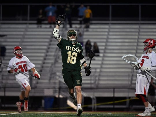 York Catholic's Cole Witman celebrates after scoring in the final seconds of the second half of a boys' lacrosse YAIAA semifinal game Wednesday, May 9, 2018, at Central York. York Catholic defeated Susquehannock 11-9 to advance to the YAIAA title game.