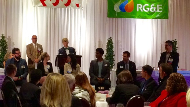 A five-person panel discusses ways Rochester, particularly its business community, can attract and keep young professionals.