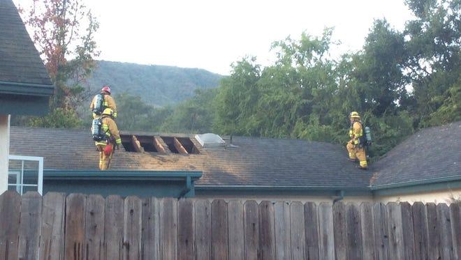 Crews respond to an attic fire in Ojai Thursday morning.