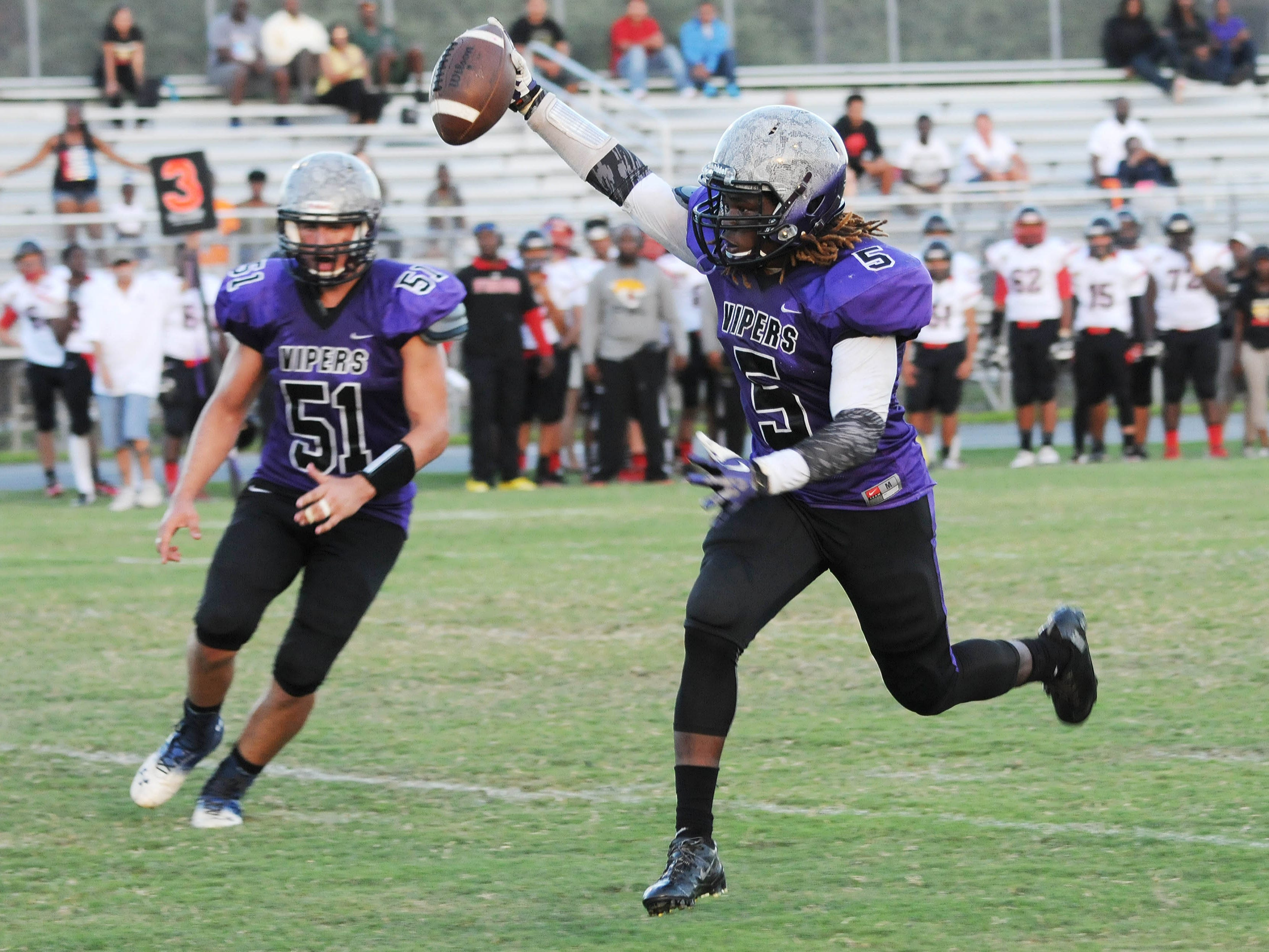 Corn Fulton of Space Coast scores a touchdown during Tuesday's spring football game against Port St. Lucie.