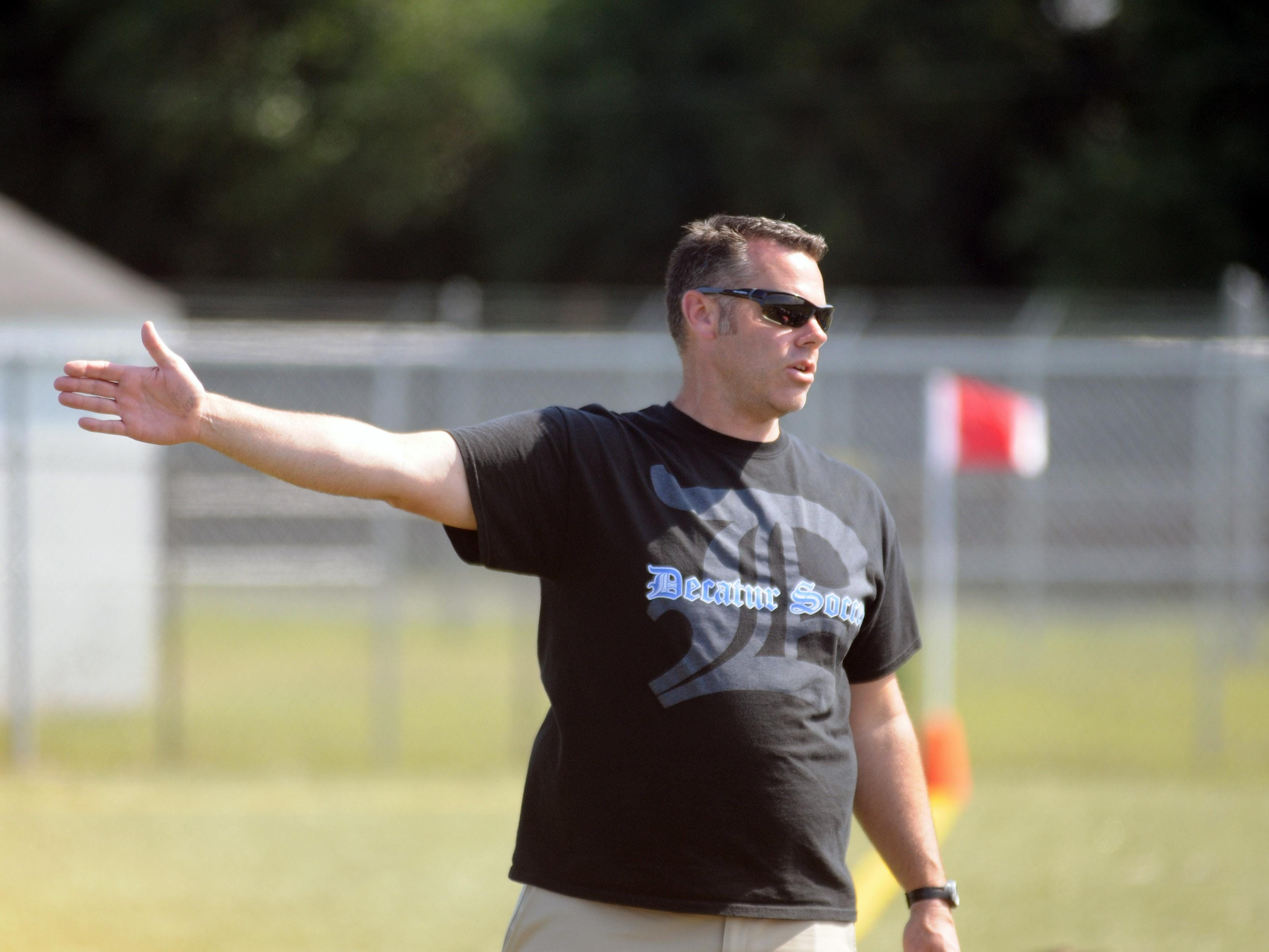 Stephen Decatur head coach Jamie Greenwood speaks with his players during the Cape Henlopen play day.