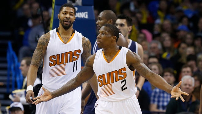 Phoenix Suns guard Eric Bledsoe (2) gestures to an official after being called for a foul in the first quarter of an NBA basketball game against the Oklahoma City Thunder in Oklahoma City, Wednesday, Dec. 31, 2014.