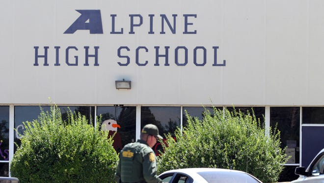 A United States Border Patrol officer patrols the perimeter at Alpine High School after a shooting  Thursday, Sept. 8, 2016, in Alpine, Texas.