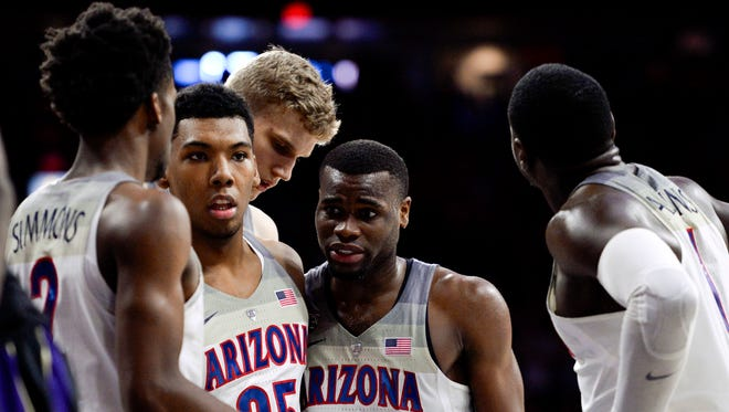 Arizona Wildcats guard Kobi Simmons (2) guard Allonzo Trier (35) forward Lauri Markkanen (10) guard Kadeem Allen (5) and guard Rawle Alkins (1) (left to right) huddle during the second half against the Washington Huskies at McKale Center in a recent game.