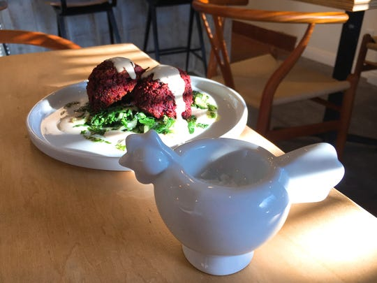 """At Moody Rooster in Thousand Oaks, an order of mock-sausage """"meatballs"""" made with beets, lentils and almond butter is served with a porcelain fowl that contains a pinch of add-your-own fleur de sel."""