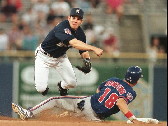 Milwaukee Brewers second baseman Mark Loretta hops over Toronto Blue Jays catcher Benito Santiago to complete a triple play in the fourth inning July 28, 1997, in Milwaukee, the third triple play in team history.