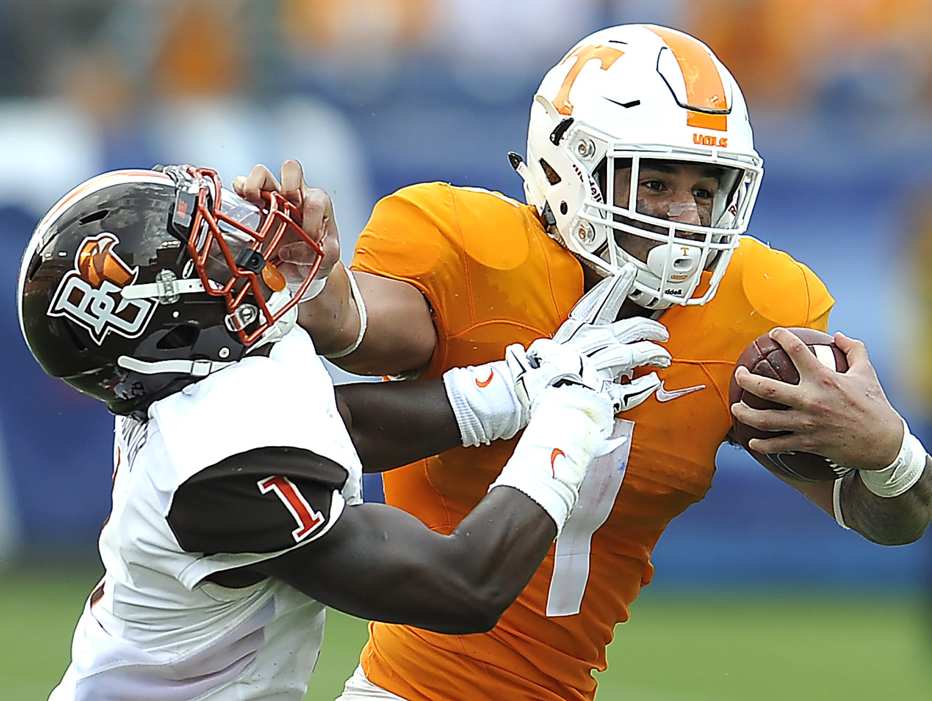 Tennessee running back Jalen Hurd (1) puts a stiffarm on Bowling Green defensive back Darrell Hunter (1) as the University of Tennessee plays Bowling Green.