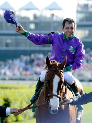 Victor Espinoza aboard California Chrome celebrates after winning the 2014 Kentucky Derby at Churchill Downs.