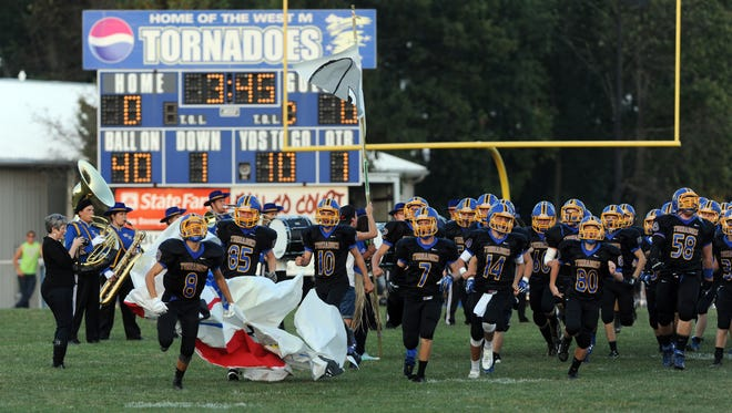 West Muskingum takes the field against Maysville during a recent season. The district is hoping to start fundraising to replace the grass turf with a synthetic surface.