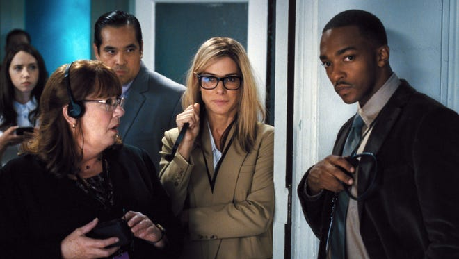Ann Dowd (from left), Dominic Flores, Sandra Bullock and Anthony Mackie star in 'Our Brand Is Crisis.'
