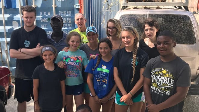 The Hearts out to Haiti mission team from Holy Name of Jesus Catholic Church is hunkered down in a safe location outside Port-Au-Prince. Rioting in Haiti's capital have kept them from reaching the airport.