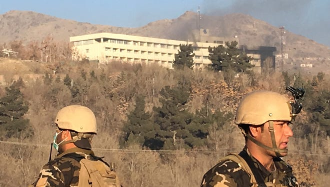 Smokes rises from the Intercontinental Hotel after an attack in Kabul, Afghanistan, Sunday, Jan. 21, 2018. Gunmen stormed the hotel in the Afghan capital on Saturday evening, triggering a shootout with security forces, officials said.
