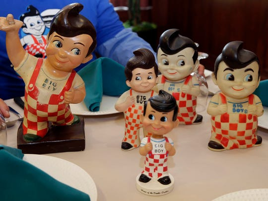 Larry Ladin shows off his commemorative Big Boy figurines at Ovation Sarah Chudnow in Mequon, which is planning a Big Boy reunion next week. He is faithfully recreating the Big Boy burger and fixins and serving to a crowd.