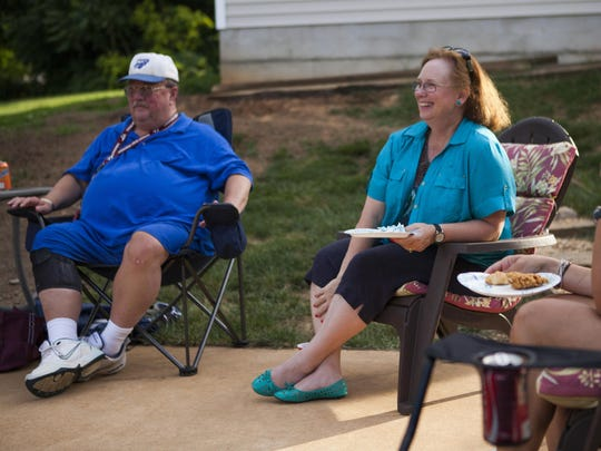 Bonnie Ball, center, sits beside her husband Ron Ball during an end-of-year picnic with players of her tennis team and their parents in Mount Sidney on June 15. Ball recently retired from teaching at Fort Defiance after being at the school for 34 years.