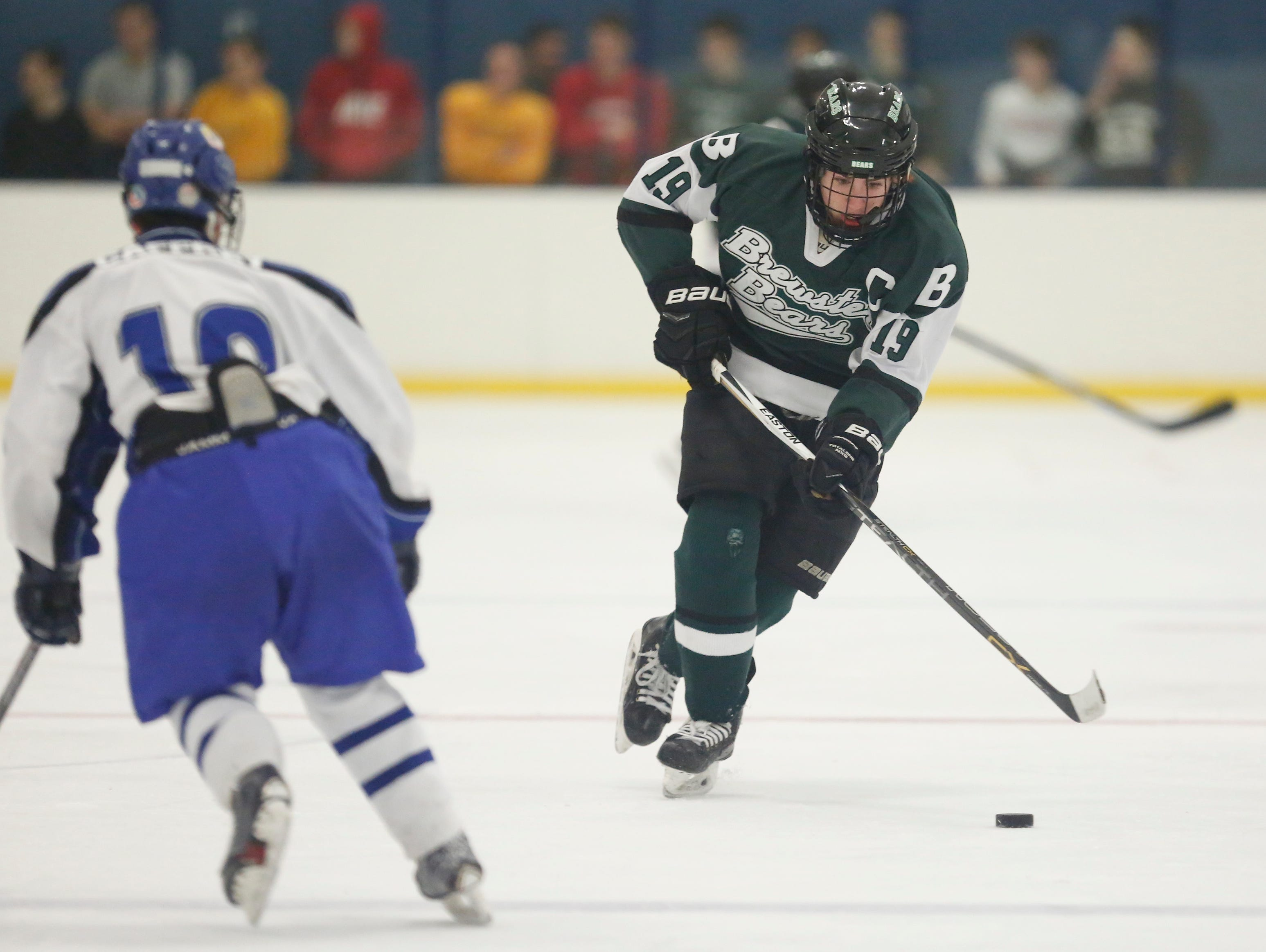 Brewster's Kyle Dineen (19) skates with the puck during their 4-4 overtime tie against Pearl River at Sport-O-Rama in Monsey on Saturday, Jan. 9, 2016.