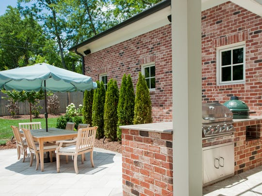 Whit Polley's outdoor space includes a kitchen equipped with a Big Green Egg.