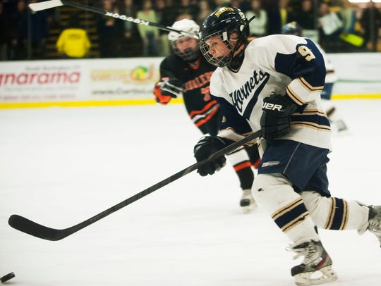 Essex's Kathleen Young (9) skates down the ice with