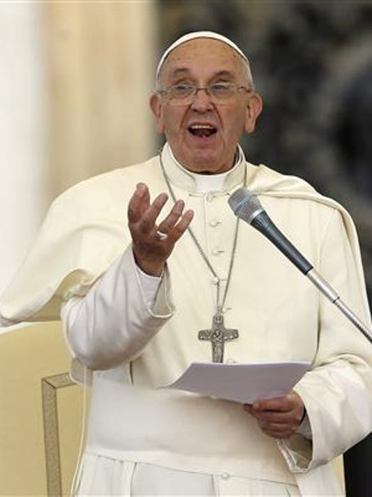 Pope Francis delivers his message on the occasion of an audience with participants of Rome's diocese convention in St. Peter's Square, at the Vatican, Saturday, June 14, 2015.