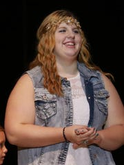 Marnie Schecklman of Greenwood reacts as it is announced she won the 13-to-18-year-old division at the Central Wisconsin's Got Talent last September.