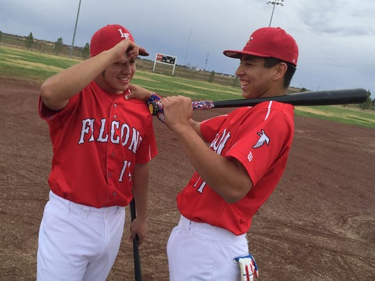 Seniors Sonny Granado, left, and Jordan Pina, right, at the Falcon baseball complex in Loving, NM.