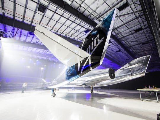 Virgin Galactic's new spaceship, unveiled Friday in Mojave, California, is the size of a small corporate jet. It was named Virgin Spaceship Unity at the suggestion of theoretical physicist Stephen Hawking.
