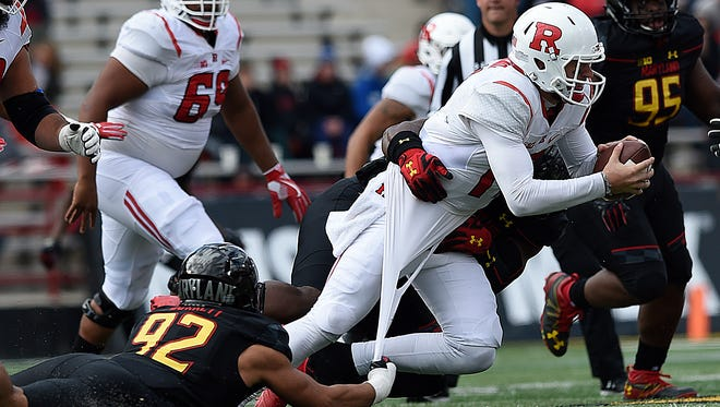 Rutgers quarterback Giovanni Rescigno, right, is sacked by Maryland Cavon Walker during the first half of an NCAA college football game, Saturday, Nov. 26, 2016 in College Park, Md. (AP Photo/Gail Burton)