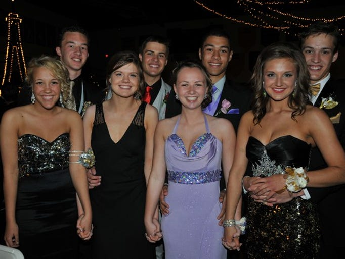 Friends gather for pictures at their 2014 prom on Saturday, May 10, at Cathedral High School in St. Cloud.