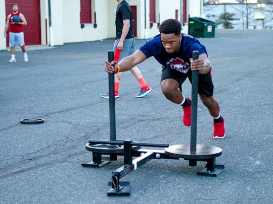 Ocean Township junior running back Tyler Thompson, 17, works out at JM Power U. in Eatontown, part of his rehabilitation after shattering his left leg late last season.