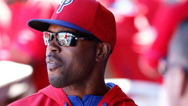 Jimmy Rollins looks out toward the field from the dugout after not playing for the third consecutive game.