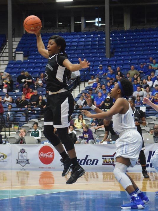Neville High School's Sha'Quandra Carter (3, front) catches a pass against South Lafourche's Kvzha Jackson (14, right) in the LHSAA Class 4A semifinals held Tuesday, Feb. 27, 2018 at the Rapides Parish Coliseum in Alexandria.