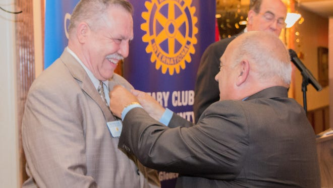 Michael​ ​Colasurdo​ ​Sr.,​ ​(right) keynote​ ​speaker​ ​and​ ​Rotarian,​ ​makes​ ​it​ ​official​ ​as​ ​he​ ​gives​ ​Chris​ ​Volker, president of ​the Rotary​ ​Club​ ​of​ ​Tri-County​​,​ ​his​ ​Charter​ ​Member​ ​pin.