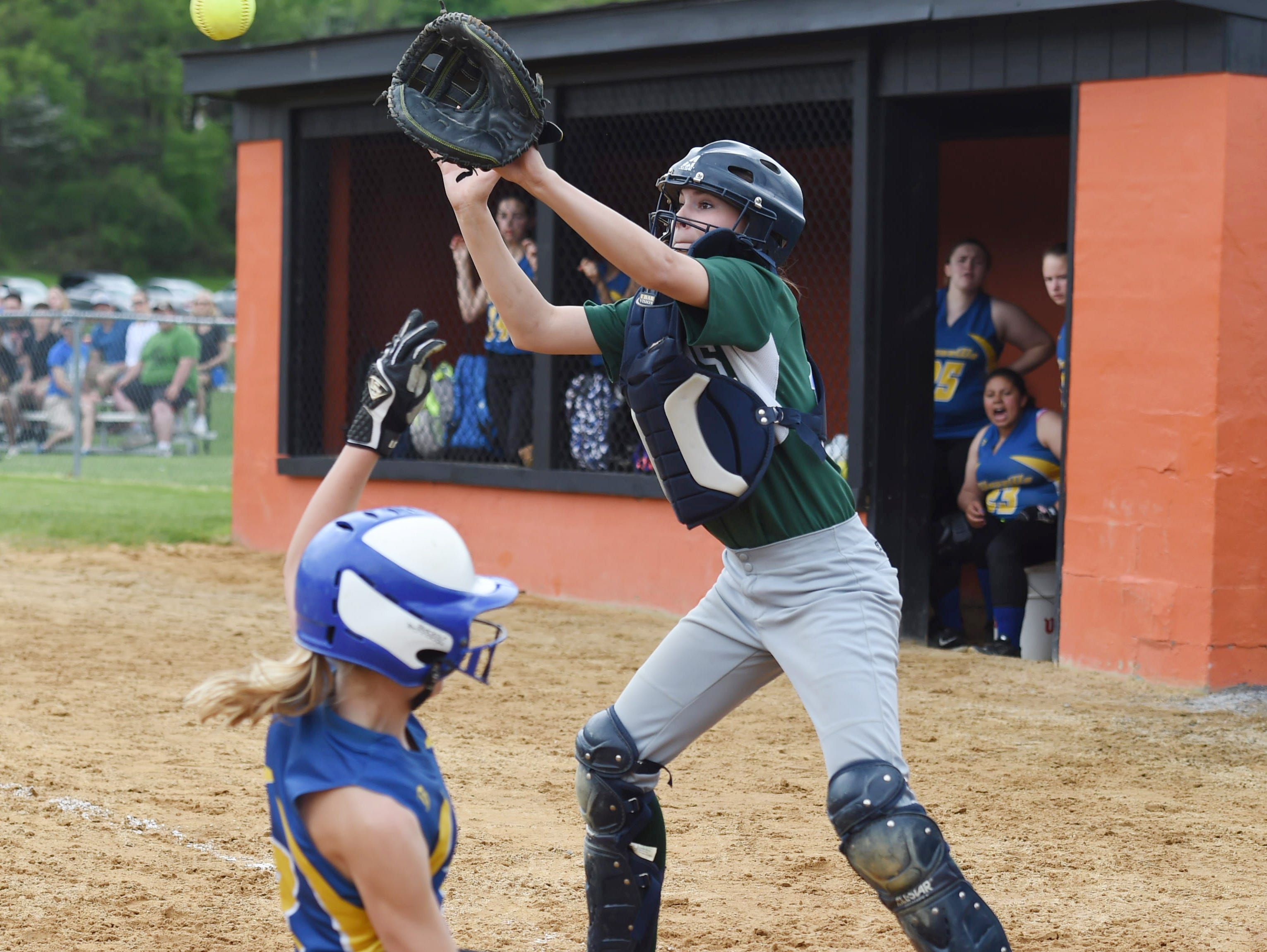Spackenkill's catcher, Maddie McCall covers home as Ellenville's Kassy Little slides in during Saturday's MHAL Division III title game held at Marlboro.