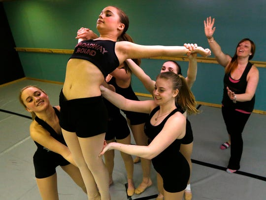 """Lindsay Williams (right) works with students as they perform """"Seven Devils"""" a contemporary dance piece, at Broadway Bound Dance Centre in Toms River."""