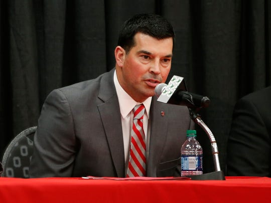 FILE - In this Tuesday, Dec. 4, 2018 file photo, Ohio State NCAA college football offensive coordinator Ryan Day answers questions during a news conference announcing his hiring as head coach to replace Urban Meyer, who announced his retirement in Columbus, Ohio. Day is the Buckeyes' co-offensive coordinator under Urban Meyer until the conclusion of the 105th edition of the Rose Bowl. Right after that, Day becomes the 25th head coach in Ohio State history, charged with preserving and improving a storied program coming off one of its most successful stretches.(AP Photo/Jay LaPrete, File)