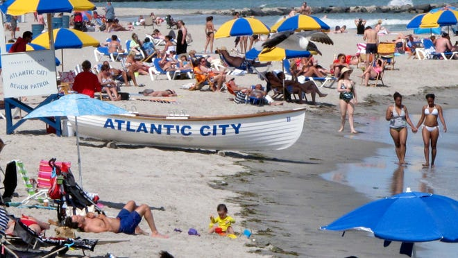 In this photo taken on June 23, 2014, beachgoers fill the sand at Atlantic City N.J. Atlantic City's mayor, Don Guardian, said on Thursday, July 10, 2014, that his city is in the midst of a painful transition from a gambling-centric resort to one with a wider variety of things to do. (AP Photo/Wayne Parry)