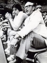 Former UE Basketball coach Arad McCutchan seems to be enjoying himself as he coaches the Indiana All-Starsduring a game on 4/16/1978 against Kentucky All-Stars. Next to McCutchan is Notre Dame star Dave Batton.