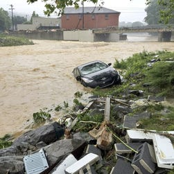 Debris from the Jordan Creek near Clendenin, W.Va., piles up against a culvert along U.S. 119 on  June 23, 2016,  before the creek's entry into the Elk River.