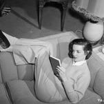 In today's celebrity photos, stars are looking at their phones. In 1951 folks like Jane Russell were captured reading books!