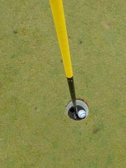 Dick Wasson, 88, took a picture of his first-ever hole-in-one,