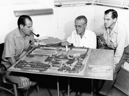 E. Stewart Williams, Harry Williams and Roger Williams with model of Palm Springs High School.