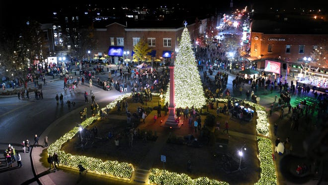 From a view in a Middle Tennessee Electric Corp. bucket truck, people gather on the Franklin square and Main Street after the City of Franklin's Christmas tree lighting ceremony on the downtown Franklin square on Thursday, Dec. 1, 2016.