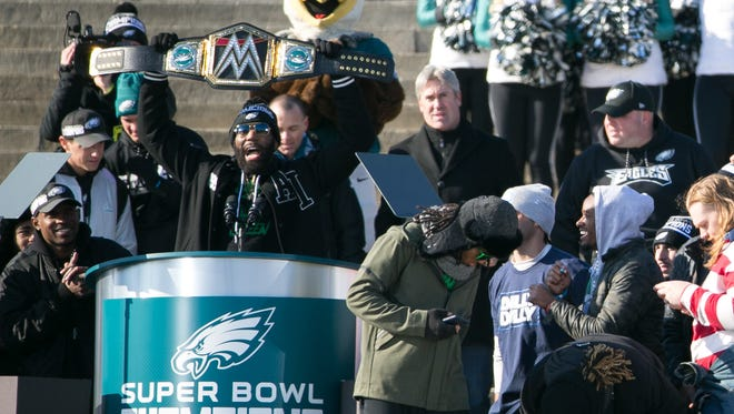 Malcolm Jenkins holds up a championship belt. Thousands gather around the Rocky steps of the Philadelphia Museum of Art as the Super Bowl LII Champions Philadelphia Eagles parade down Broad Street ending at the art museum in Philadelphia.
