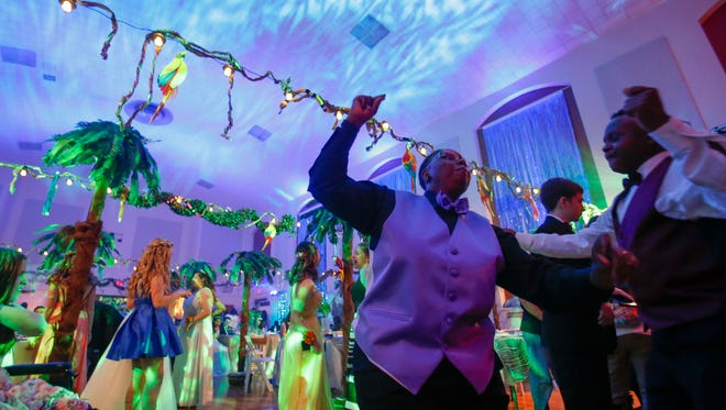 Justice McTeer, 20, (center) dances during the Nemours/Alfred I. duPont  Hospital for Children prom for patients Saturday.