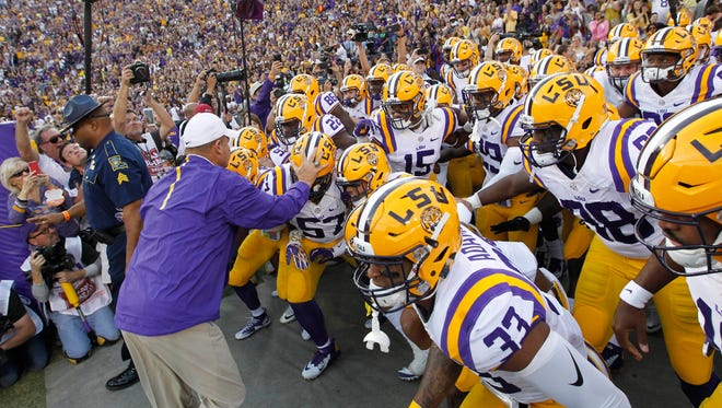 LSU coach Les Miles leads the Tigers onto the field prior to kickoff against Florida on Oct. 17.