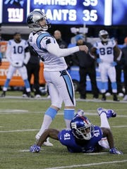Peter Morgan/AP The Giants' Dominique Rodgers-Cromartie (41) and Panthers' Graham Gano (9) watch as Gano's kick is good during the second half Sunday. New York Giants' Dominique Rodgers-Cromartie (41) and Carolina Panthers' Graham Gano (9) watch as Gano's kick is good during the second half of an NFL football game Sunday, Dec. 20, 2015, in East Rutherford, N.J. The Panthers won 38-35. (AP Photo/Peter Morgan)