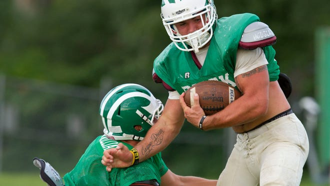 Brick running back Ray Fattaruso tries to break a tackle on Aug. 20.